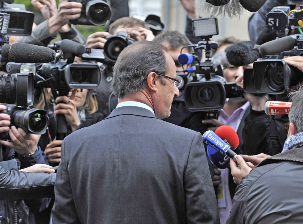 François Hollande greets the media after voting yesterday