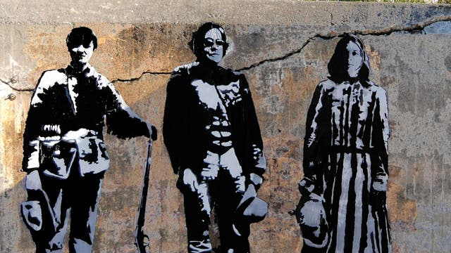 Blek le Rat depicts himself (centre) in one of his street stencils