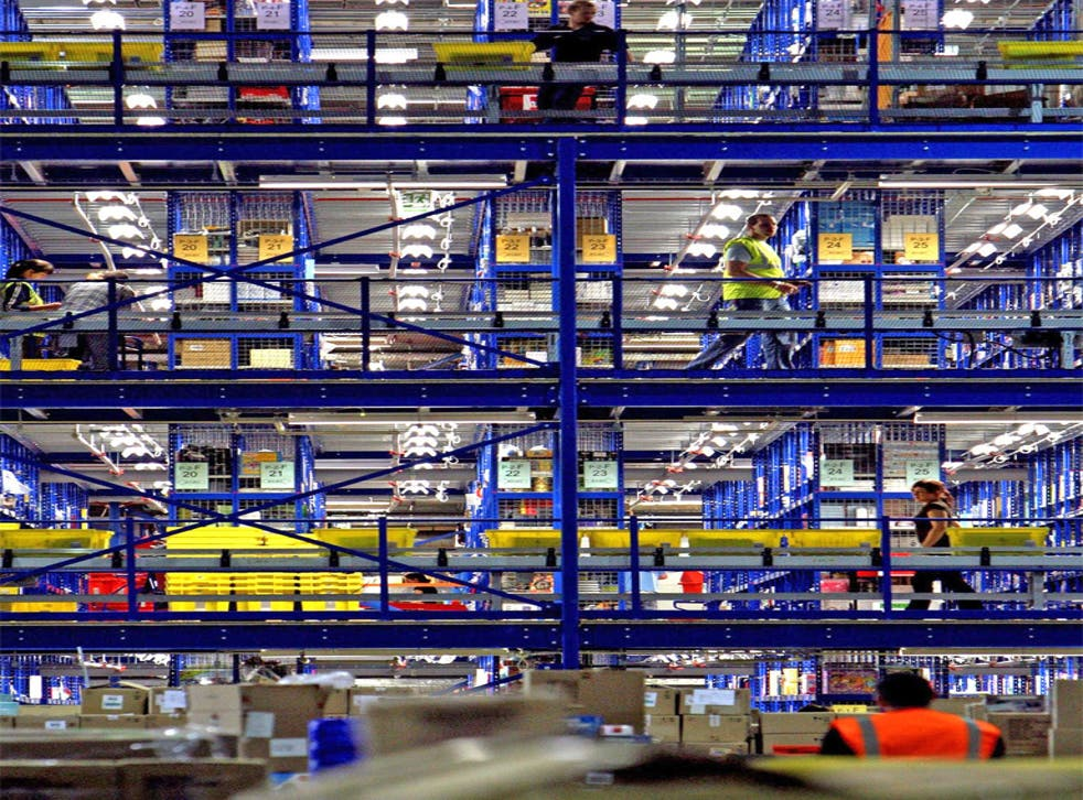 Take your pick: Amazon staff in a typical distribution centre in Milton Keynes. The US firm is now moving into the industrial-supply business
