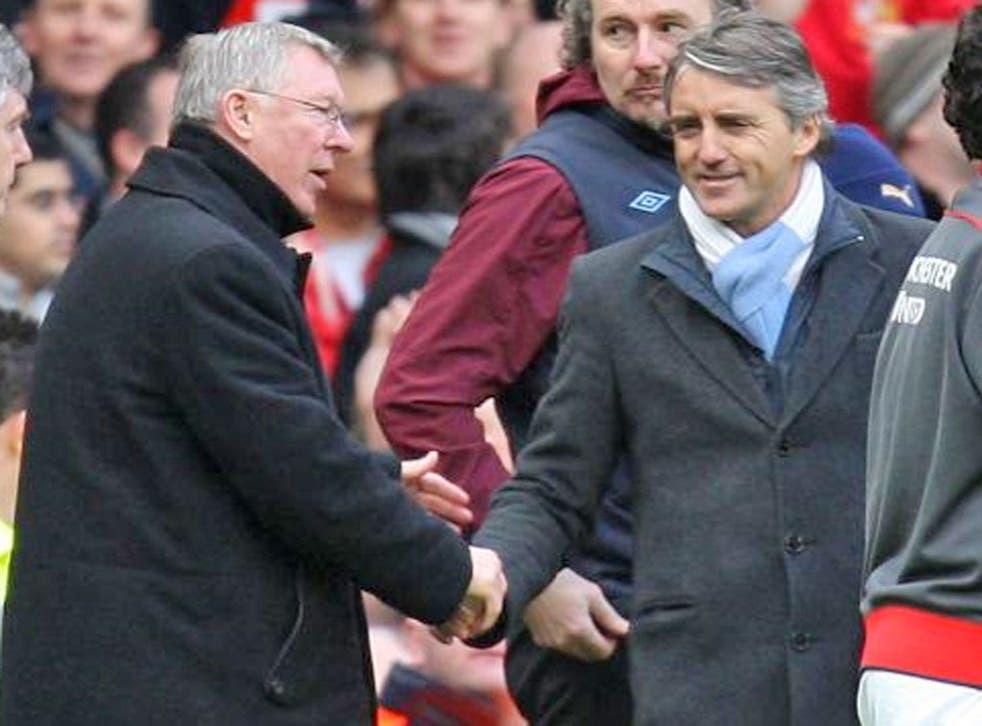 United's Alex Ferguson and City's Roberto Mancini shake hands