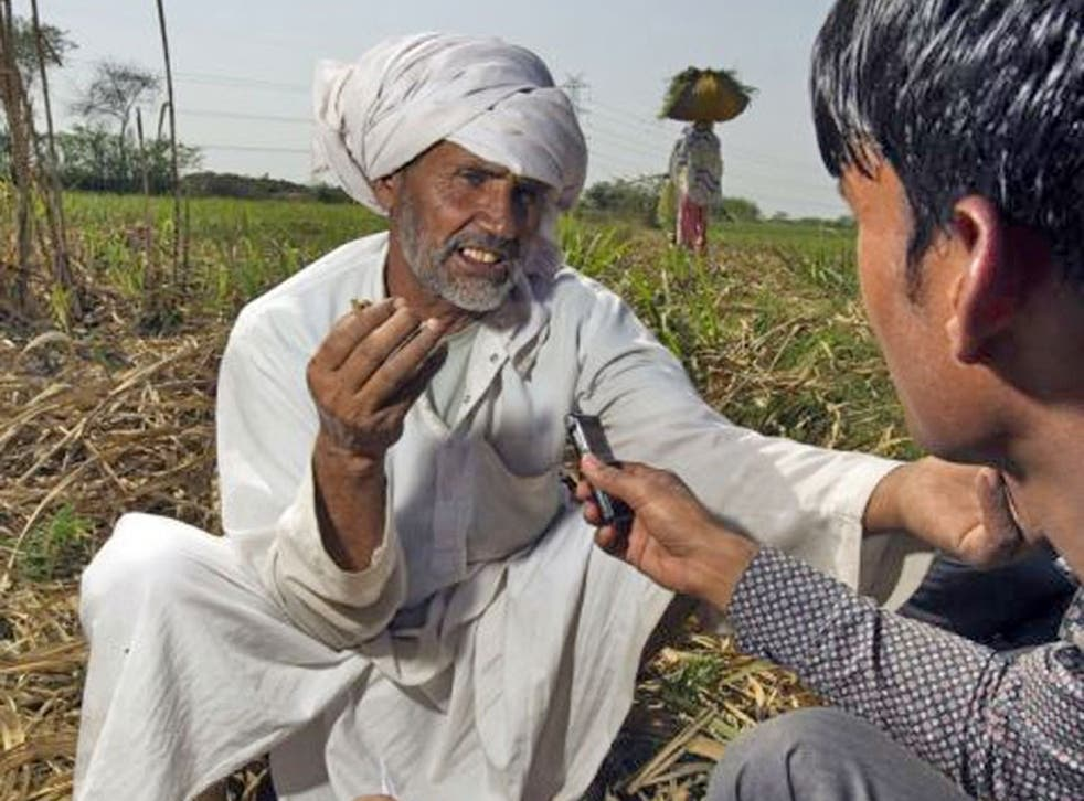 Agricultural reporter Mohamed Arif interviews Mormal Khan for Radio Mewat, a community radio station helping this traditional farming community