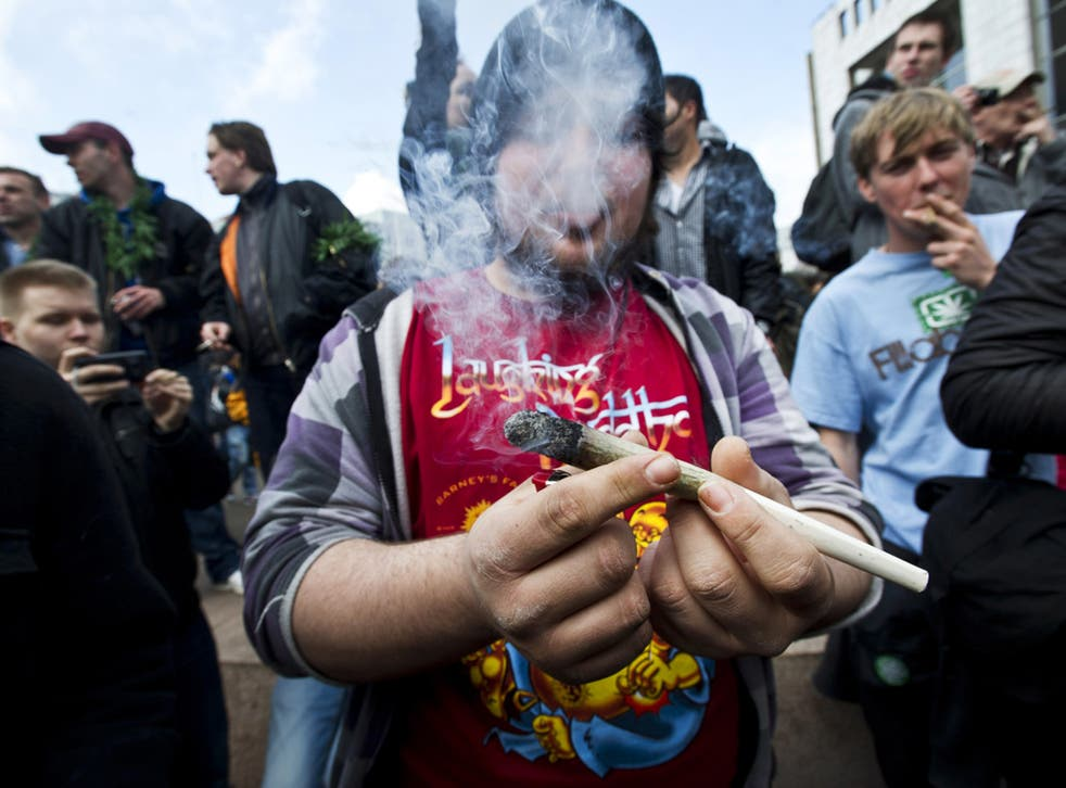 Protesters smoke marijuana during a demonstration against new government legislation calling for the creation of a 'weed pass' and the stopping of the substance's sale to foreigners, in Amsterdam last week.