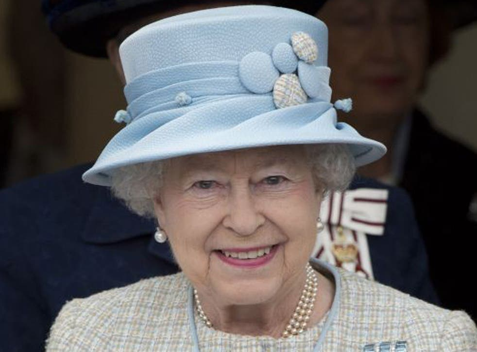 On the job: the Queen yesterday in Aberfan, Wales