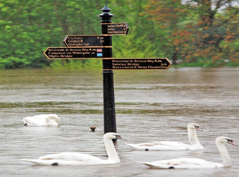 Signs showing walks along the River Severn in Worcester. Nearly 30mm (1.2in) of rain fell in 12 hours in some areas of the UK yesterday