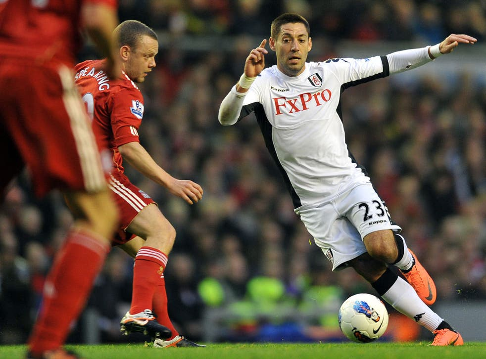 Fulham's Clint Dempsey in action against Liverpool