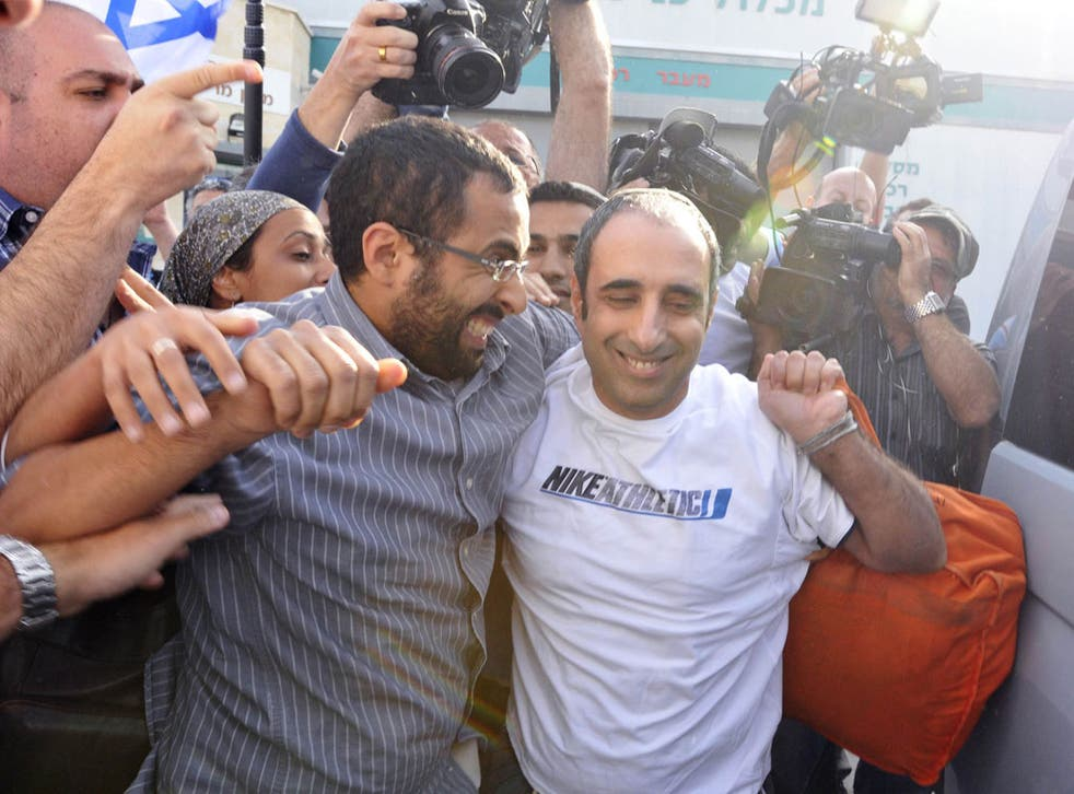Hagai Amir, right, greets his supporters yesterday after being released from prison
