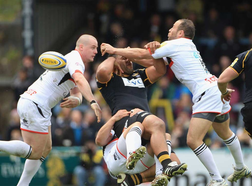 Wasp swatted: No 8 Billy Vunipola feels the full force of the Newcastle Falcons defence at Adams Park