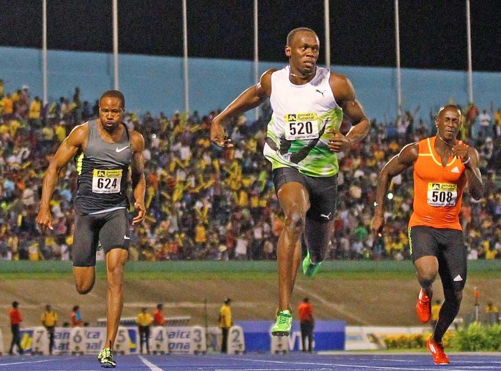 Usain Bolt (left) wins the 100m at the Jamaica Invitational