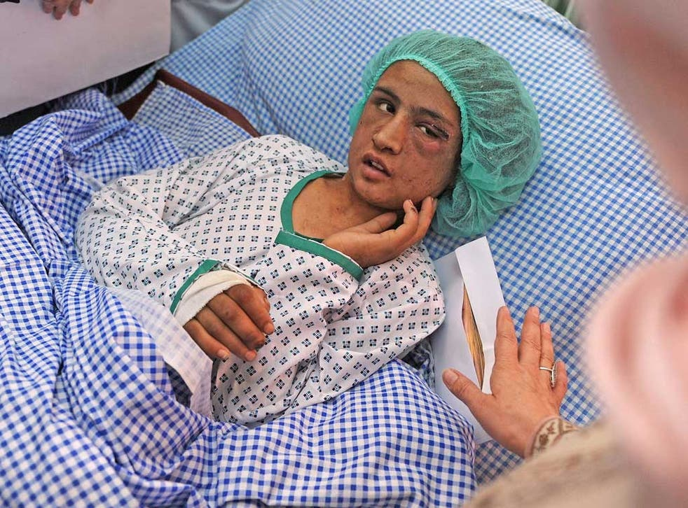 Sahar Gul speaks to the Minister of Women's Affairs as she recovers in hospital last December
