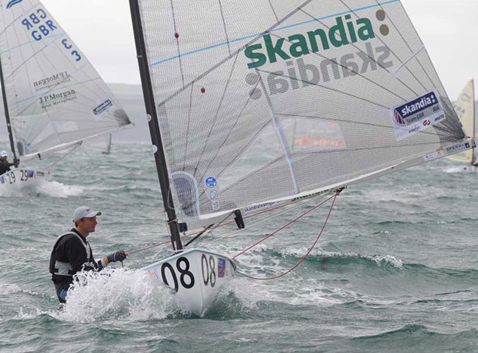 Giles Scott leads four times Olympic gold medallist Ben Ainslie to win the Finn national championship in Falmouth