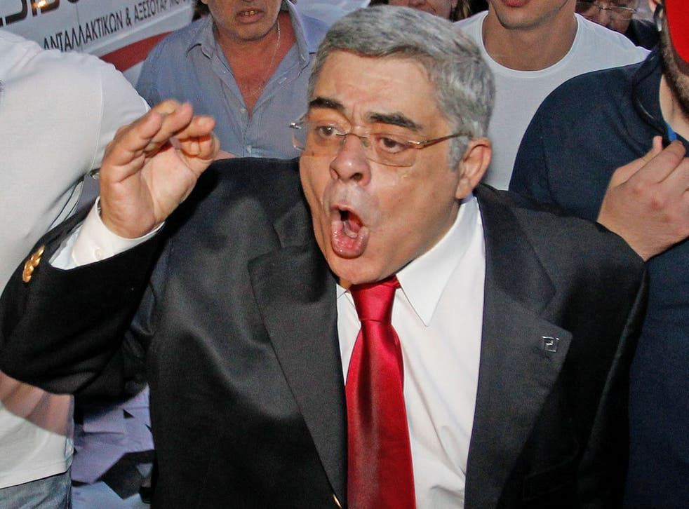 Journalists were told to stand to attention for the Golden Dawn leader Nikos Michaloliakos