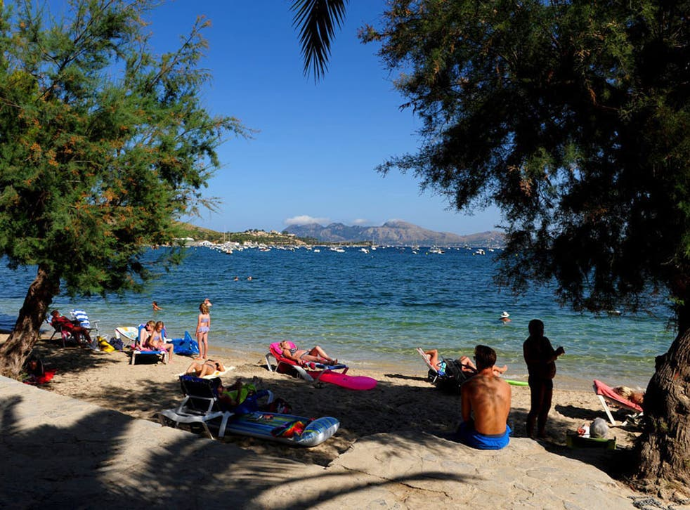 Money matters: Tourists relax in Mallorca. The euro has slumped in value this week, increasing the spending power of British travellers