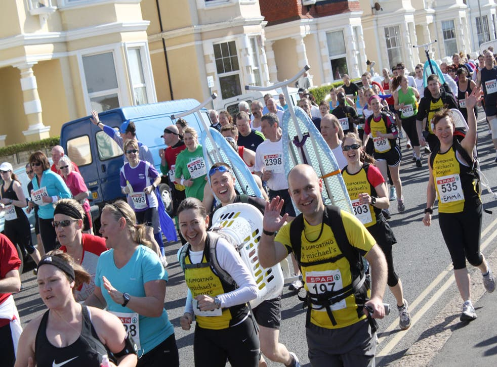 Phil Szomszor and his friends ran the Hastings Half Marathon with ironing boards strapped to their backs to raise money for St Michael's Hospice