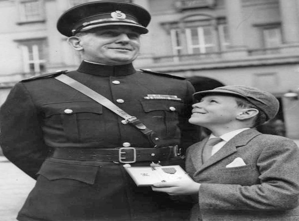 Qualtrough with his son Henry after receiving the George Medal in 1967