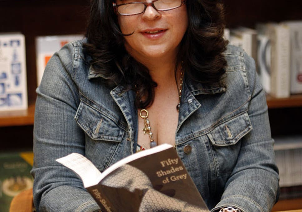 Text in the city: the author EL James with a copy of 'Fifty Shades