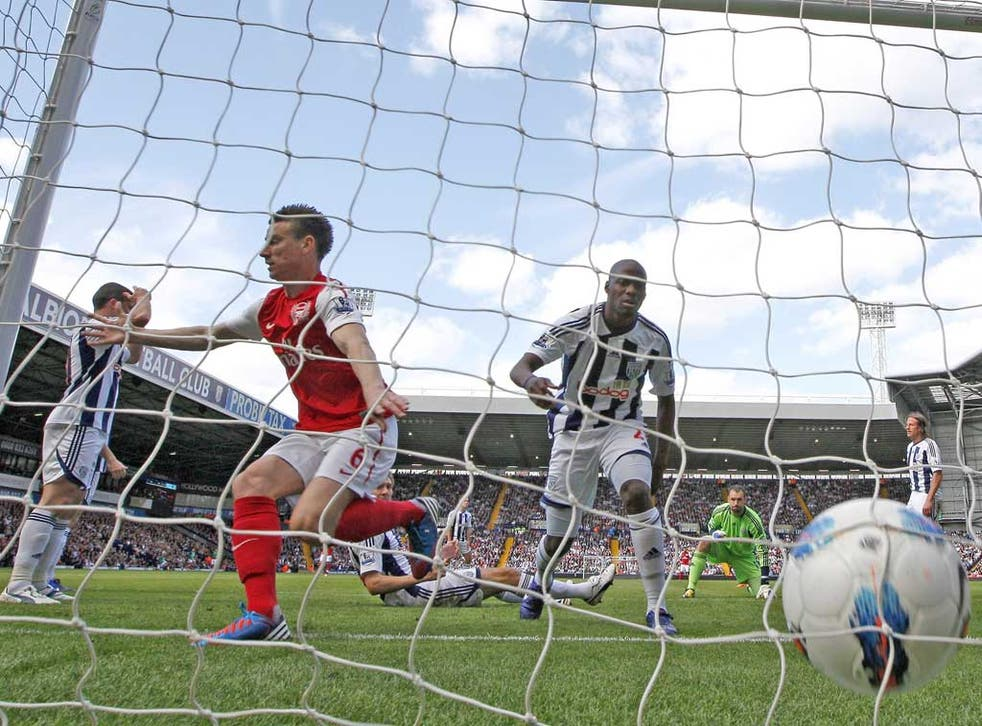 Laurent Koscielny scores the goal that ensured Champions League football for Arsenal