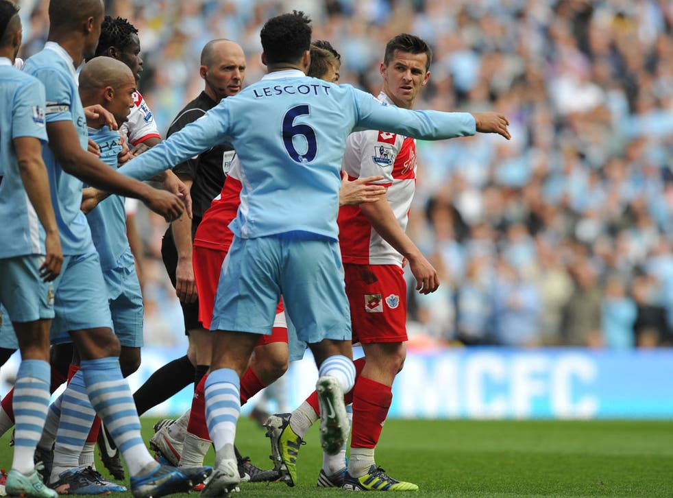 Joey Barton had to be ushered from the field