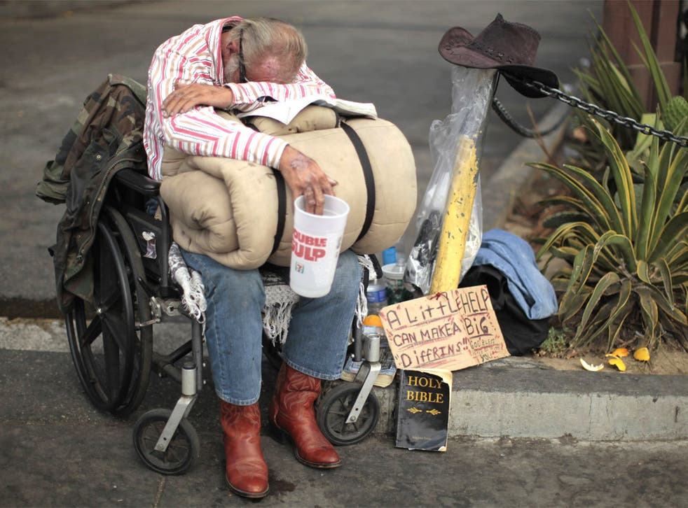 A homeless man in Los Angeles, California: the state is cutting healthcare and welfare payments and the Governor is calling for tax rises to avert disaster