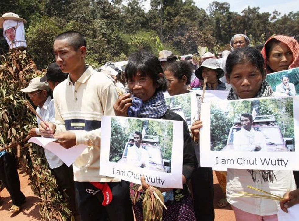 Protesters march to the spot where the activist Chut Wutty was shot dead last month