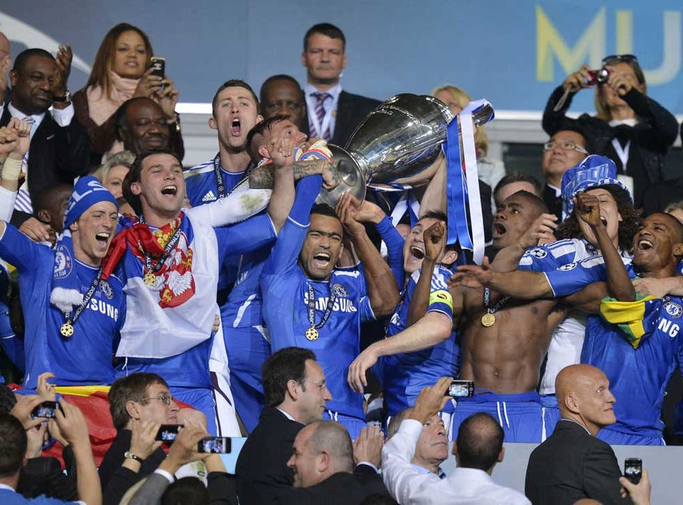 Chelsea's Jose Bosingwa holds up the trophy at the end of the Champions League final