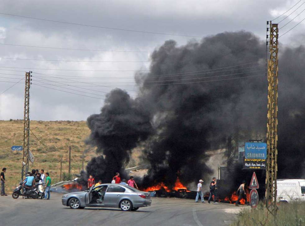 Roads near the town of Halba were blocked by blazing tyres yesterday