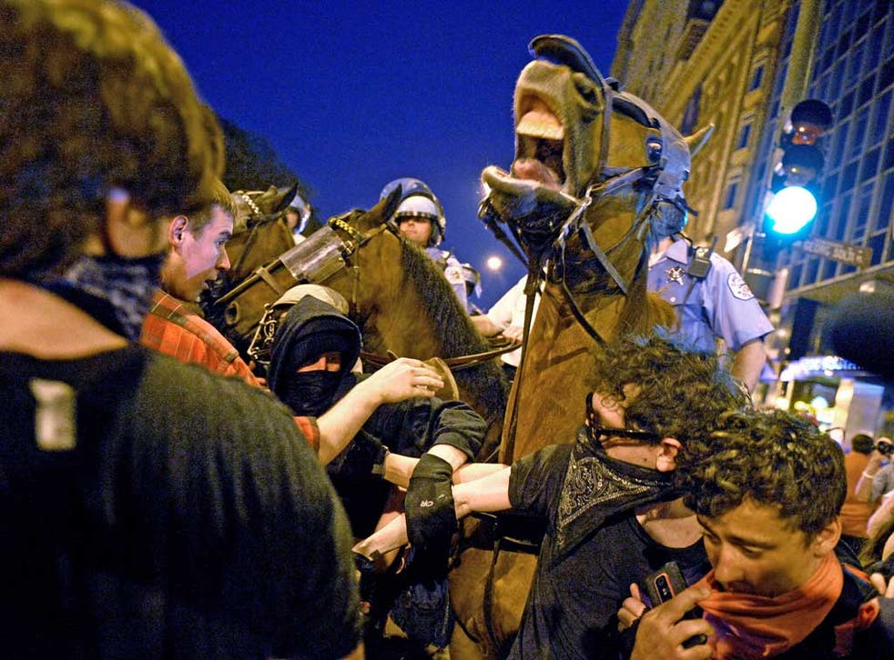 Protesters clash with mounted police during a march through Chicago before the Nato summit