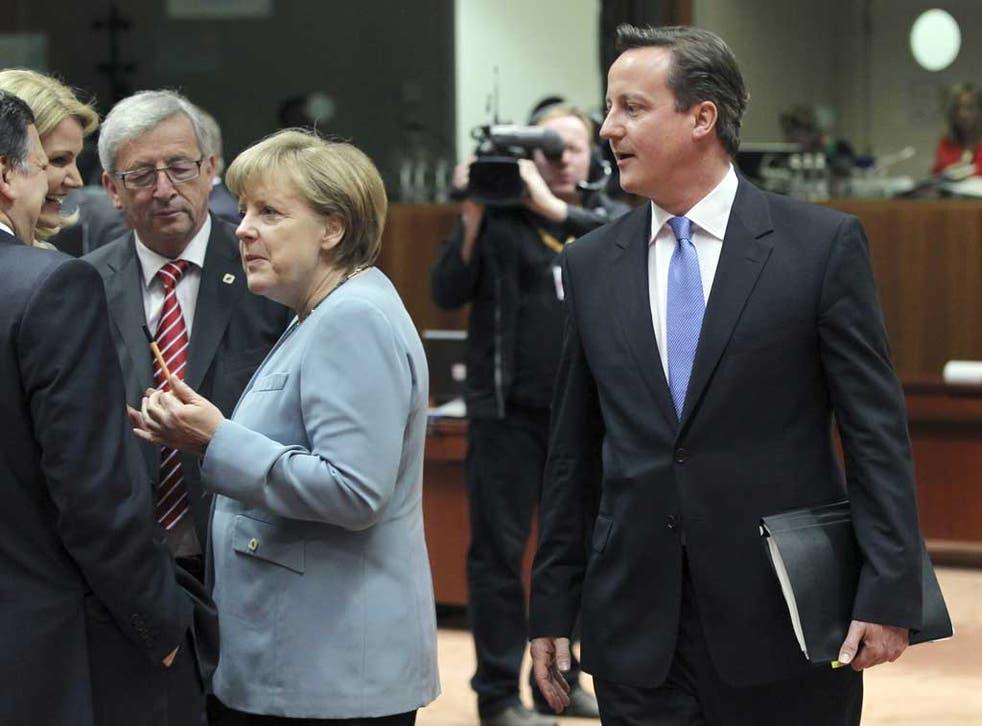 David Cameron walks past Jose Manuel Barroso, Helle Thorning-Schmidt, Jean-Claude Juncker and Angela Merkel during at last night's summit in Brussels