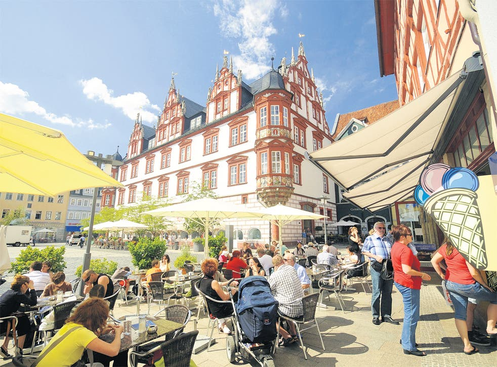 Market square cafés like this one are popular meeting places for students in Coburg, Bavaria