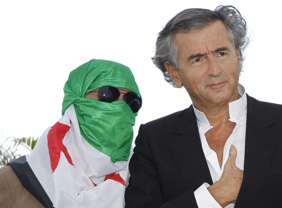 Levy and a Syrian dissident pose during the photocall for his new film <i>Le Serment de Tobrouk</i>