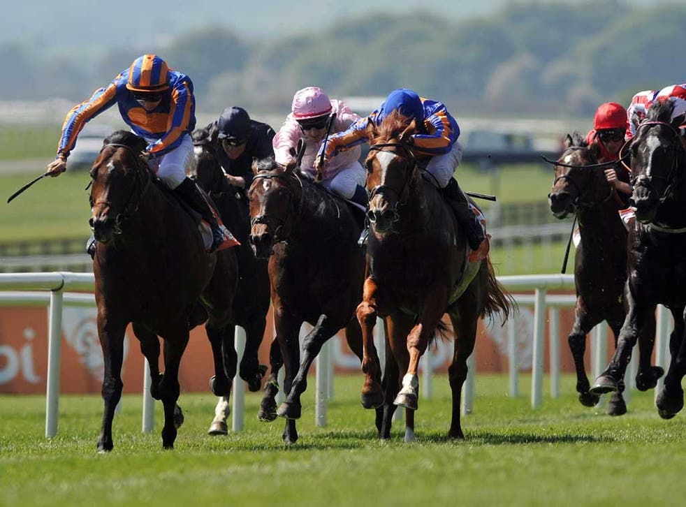 Electric turn of pace: Power (left), ridden by Joseph O'Brien, quickens clear of his rivals in yesterday's Irish 2,000 Guineas at the Curragh