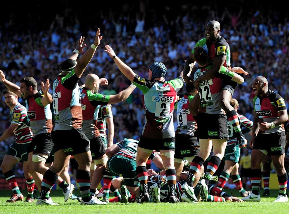 Mighty quins: Harlequins' players celebrate at the end of the Premiership final against Leicester