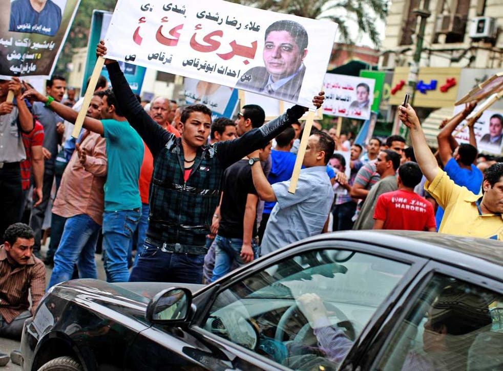 Coptic Christians protest in Cairo yesterday, demanding the release of Copts detained for political reasons