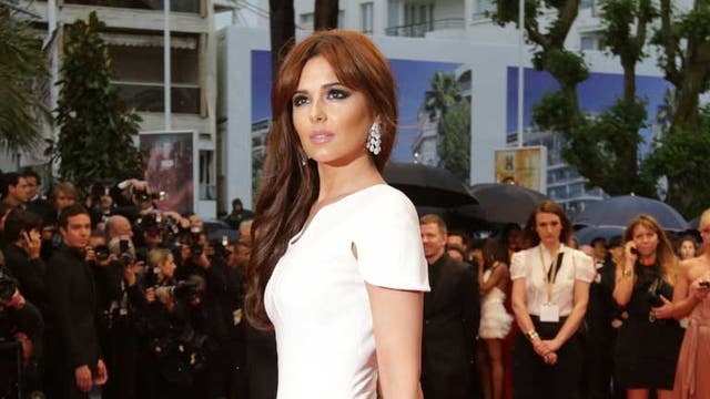<p><strong>Cheryl Cole, Stephane Rolland</strong></p> <p>Extending her lashes to match the length of the feathers at the hem of her Stephane Rolland dress is an interesting exercise in co-ordinated dressing. Have her lips been varnished solid into that pout?</p>