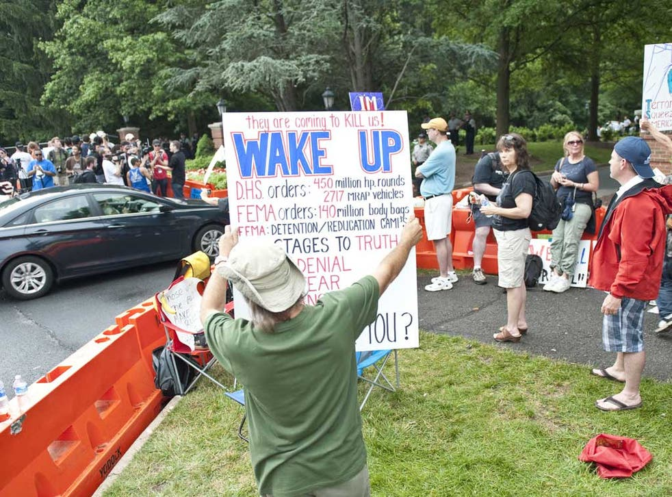 Protesters in Chantilly, Virginia, where the Bilderberg conference is taking place