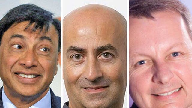 Corporate carriers of the torch: (from left) Britain's tycoon Lakshmi Mittal, the deal-maker Christos Angelides, and the other man from Samsung Andy Griffiths