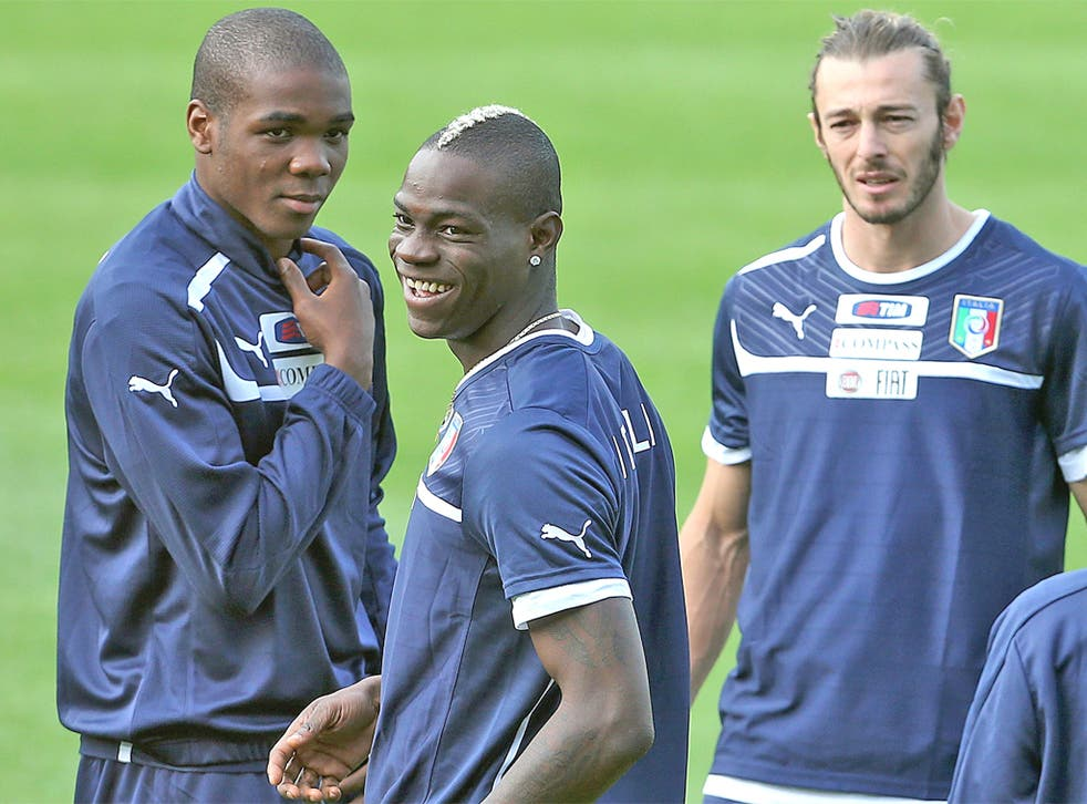 Italy's Mario Balotelli enjoys training with team-mates yesterday
