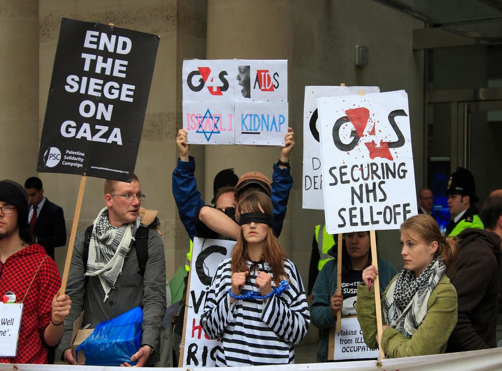 Activists protest against G4S outside the London Stock Exchange yesterday