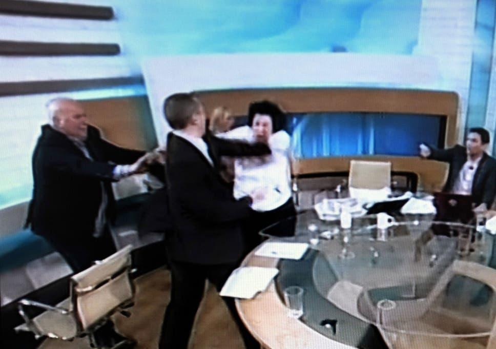 Greek police hunt far-right MP Ilias Kasidiaris over live TV