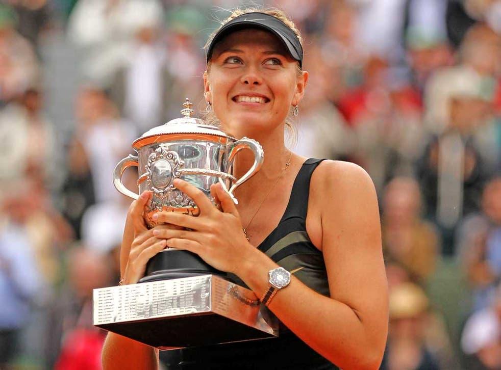 A happy Maria Sharapova holds the Coupe Suzanne Lenglen