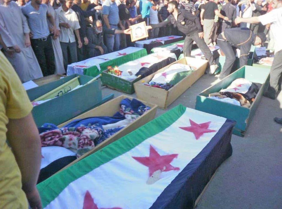 Protesters in Deraa at the funeral of people they say were killed by Assad's forces