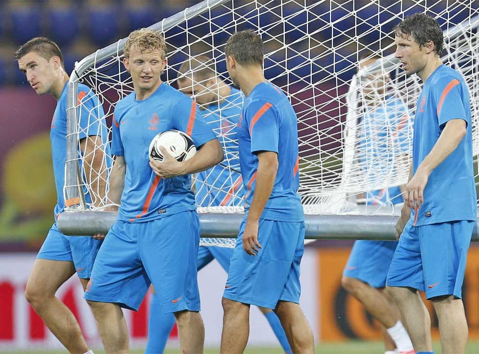 The Dutch players including Dirk Kuyt (with ball) and Marc van Bommel at training yesterday