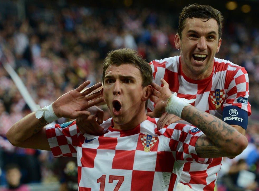 Mario Mandzukic (left) is congratulated after scoring Croatia's equaliser