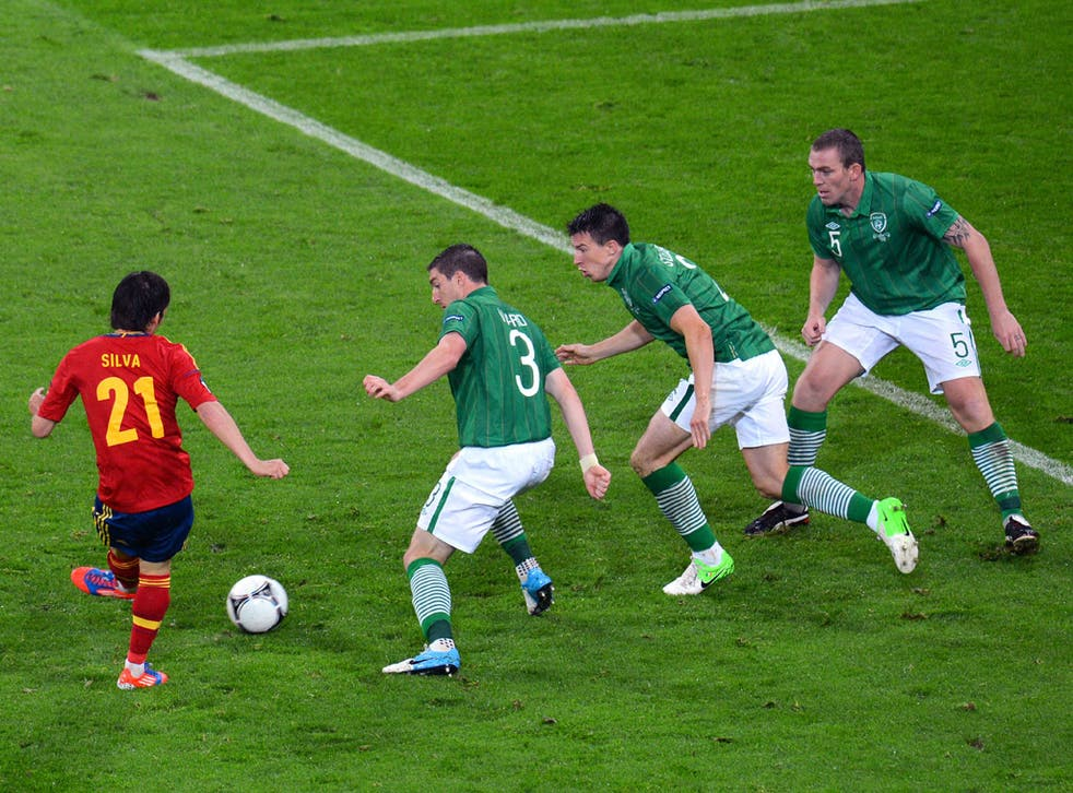 David Silva (left) outfoxes the Ireland defence to score Spain's second last night