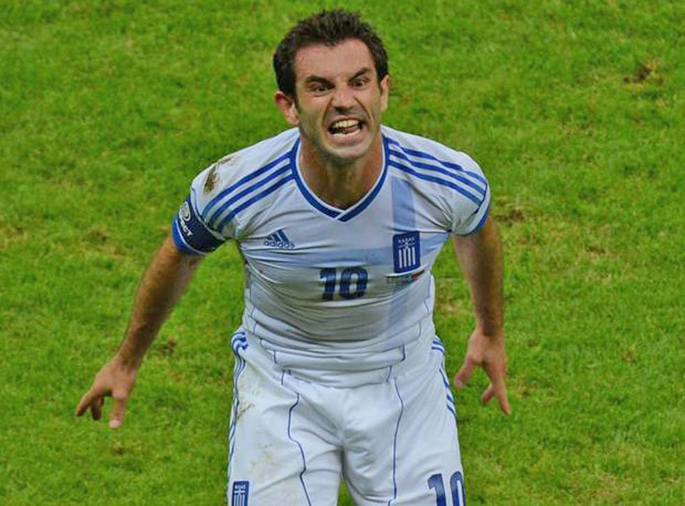 Greek bail-out: Giorgos Karagounis celebrates the goal that helped to save his team from a European Championship exit in last night's win over Russia