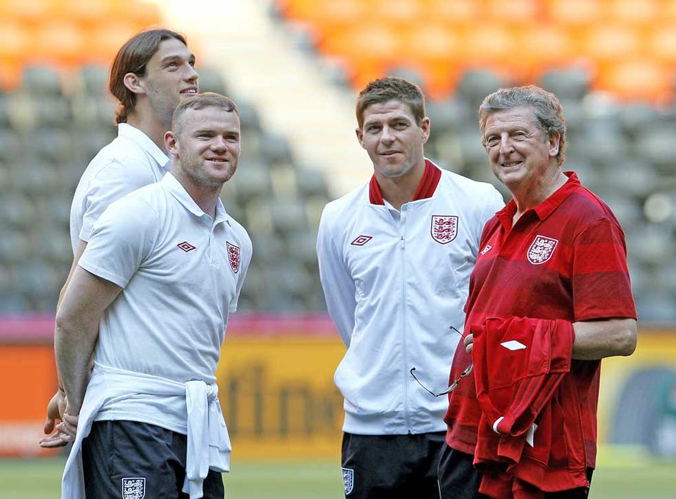 England manager Roy Hodgson with (from left) Andy Carroll, Wayne Rooney and Steve Gerrard
