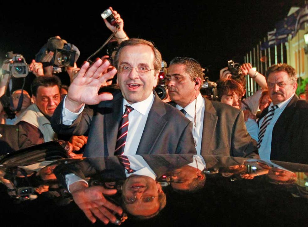 Antonis Samaras, leader of the New Democracy party, waves to supporters