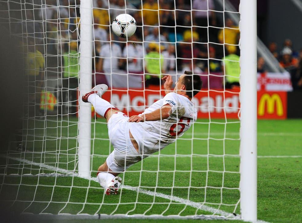 John Terry clears the ball away