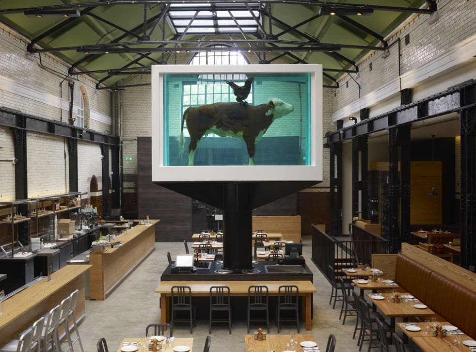 Dish of the day: The restaurant is dominated by an enormous Damien Hirst vitrine containing an embalmed cow being ridden by a cockerel