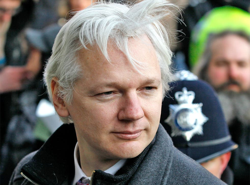 British authorities have threatened to force their way into Ecuador's London embassy to arrest Julian Assange