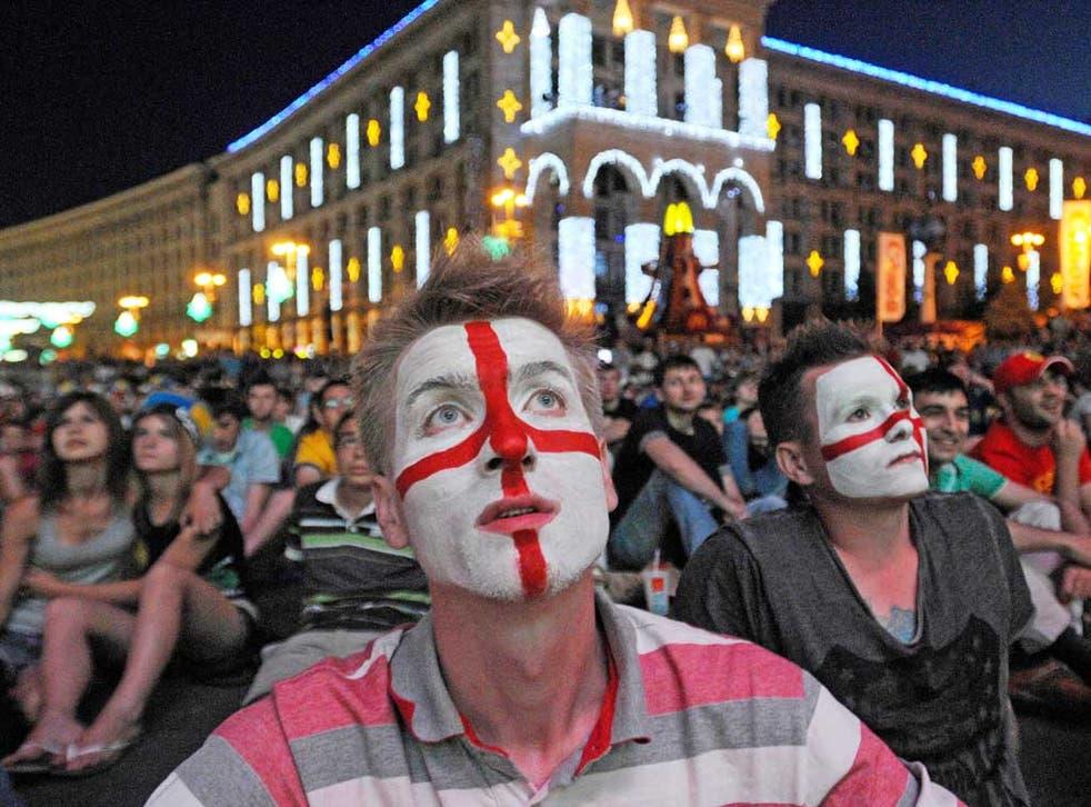 England supporters watch the drama unfold in Kiev's fan zone last night